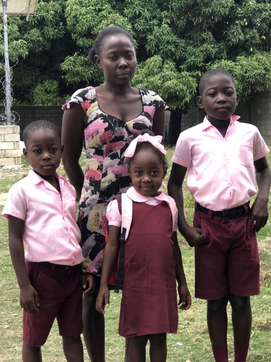 Mirlande with her 3 children